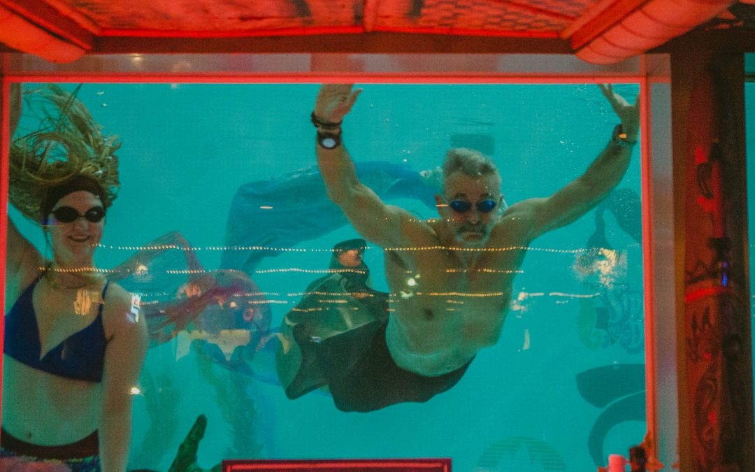 Aaron Tippin Swims with Mermaids to Raise Money for Veterans